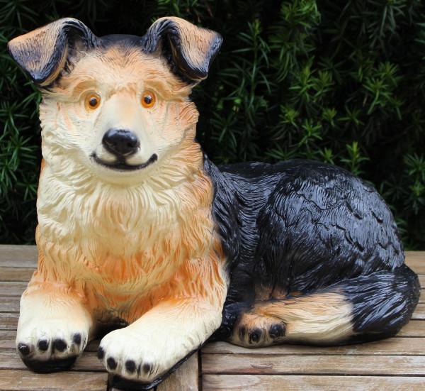 Dekorationsfigur Hund Welpe Border Collie liegend H 32 cm Dekofigur Gartenfigur Hundedeko Kunstharz